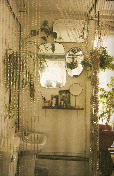 Antique mirrors and plants in the bathroom